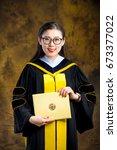 chinese girl in graduation... | Shutterstock . vector #673377022