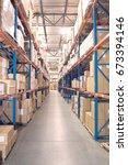 cardboard boxes on shelves in... | Shutterstock . vector #673394146
