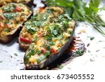 stuffed eggplant from the oven | Shutterstock . vector #673405552