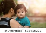 young indian mother with her... | Shutterstock . vector #673415272