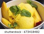 mango sorbet  summerish dessert ... | Shutterstock . vector #673418482