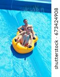 Two People In A Water Slider A...