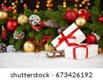 christmas decoration on fir... | Shutterstock . vector #673426192