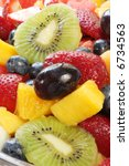 Fresh fruit salad in close-up.  Healthy eating. - stock photo