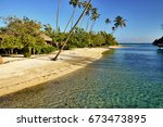 Small photo of Pristine South Pacific island beach with palm trees and tropical vegetation