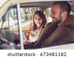 young couple on a road trip ... | Shutterstock . vector #673481182