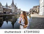 young woman tourist walking... | Shutterstock . vector #673493002