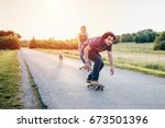 skateboarding couple having fun ... | Shutterstock . vector #673501396