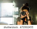 A Lady Holding Camera And Focu...