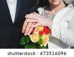 brides hands and wedding rings | Shutterstock . vector #673516096