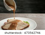 Pouring Tasty Turkey Gravy Ont...
