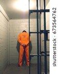 prisoner standing against the... | Shutterstock . vector #673564762