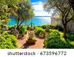 mediterranean park on lago di... | Shutterstock . vector #673596772