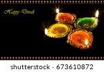 diwali colorful clay lamps... | Shutterstock . vector #673610872