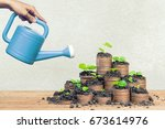 hand with watering can pouring... | Shutterstock . vector #673614976