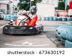 karting racer in action  go... | Shutterstock . vector #673630192