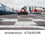 karting racer on finish line ... | Shutterstock . vector #673630198