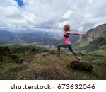 young happy woman jumping on... | Shutterstock . vector #673632046