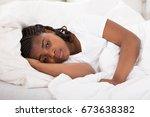 girl having sleeplessness night ... | Shutterstock . vector #673638382