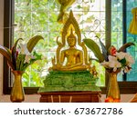 Small photo of Buddha statue. Activities of Buddha holy day to enter temple to make merit, listen to dharma and donate money to dedicate in temple. Kind of merits keep precepts in temple waxing and waning moon day