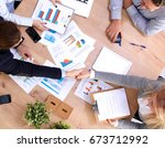business meeting at the table... | Shutterstock . vector #673712992