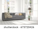 white room with sofa and green... | Shutterstock . vector #673720426