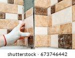 installation of ceramic tiles....   Shutterstock . vector #673746442