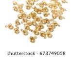 golden capsule with cosmetic... | Shutterstock . vector #673749058