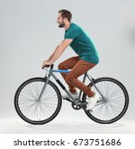 handsome young man riding... | Shutterstock . vector #673751686