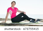fitness woman relaxing after... | Shutterstock . vector #673755415