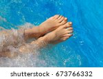 bare feet of woman on the pool...   Shutterstock . vector #673766332