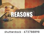 Small photo of reasons with blurring business office background, businessman working on computer at office