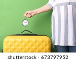 woman weighting heavy luggage... | Shutterstock . vector #673797952