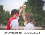 asian mother and her son... | Shutterstock . vector #673803115