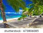 hammock between palm trees on a ... | Shutterstock . vector #673806085