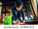 Small photo of asian businessman start up working at home