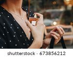young woman wearing black and... | Shutterstock . vector #673856212