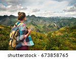 traveler with backpack enjoying ... | Shutterstock . vector #673858765