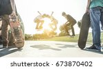 young skaters jumping with... | Shutterstock . vector #673870402