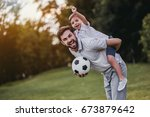 handsome dad with his little... | Shutterstock . vector #673879642
