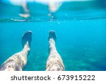 split above and underwater... | Shutterstock . vector #673915222
