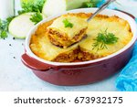 Stock photo homemade lasagna with bolognese sauce of zucchini and minced meat on blue concrete or stone 673932175