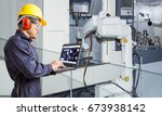 engineer using laptop computer... | Shutterstock . vector #673938142