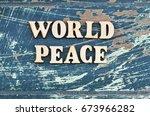 world peace written with wooden ... | Shutterstock . vector #673966282