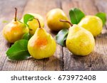 fresh pears with leaves on...   Shutterstock . vector #673972408