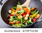 stir fried vegetables in a wok... | Shutterstock . vector #673973158