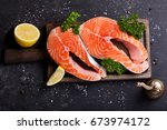 fresh salmon steaks with... | Shutterstock . vector #673974172