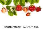 strawberries on white... | Shutterstock . vector #673974556