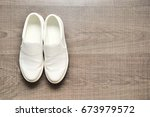 white minimal style shoes on...   Shutterstock . vector #673979572