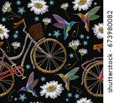 embroidery bicycle chamomiles... | Shutterstock .eps vector #673980082